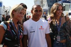 Lewis Hamilton, McLaren Mercedes and Formula Una's in the paddock