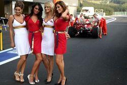 Martini Girls in the pitlane as Scuderia Ferrari team members take a rear view