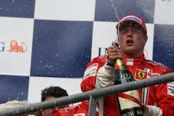 Podio: ganador de la carrera Kimi Raikkonen, Scuderia Ferrari