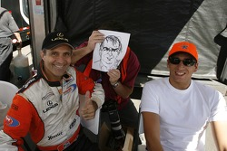 Mark Patterson and Justin Wilson share a laugh with Motorsport.com's Eric Gilbert and his caricature