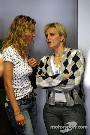 Christina Surer talking to Tina Thörner, girlfriend of Mattias Ekström