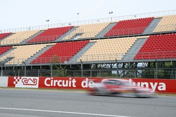 The grandstands are still empty while the DTM cars drive by