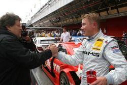 Norbert Haug, Sporting Director Mercedes-Benz congratulates Mika Hakkinen, Team HWA AMG Mercedes, wi