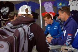 James Courtney and David Besnard signing autographs