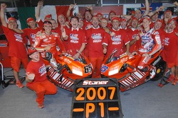 Celebrations at Ducati: 2007 MotoGP champion Casey Stoner and race winner Loris Capirossi celebrate with their team