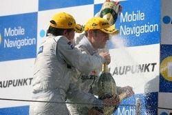 Podium: race winner Jamie Green, Team HWA AMG Mercedes, gets a champagne shower
