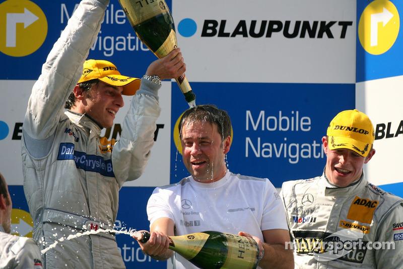 Podium: Gerhard Ungar, Chief Designer AMG, gets a champagne shower from Bruno Spengler, Team HWA AMG
