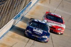 Martin Truex Jr. leads Denny Hamlin