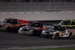 Mike Skinner, Josh Wise and Jacques Villeneuve race three-wide