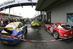 The top-three finishing cars in parc fermé