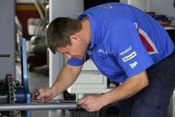 A iSport mechanic prepares one of the cars for the start of the weekend