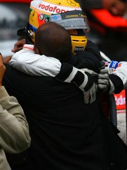 Pole winner Lewis Hamilton, McLaren Mercedes, celebrates with his father
