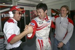 Kazuki Nakajima celebrates pole position