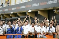 Campos Grand Prix team celebrate Vitaly Petrov victory