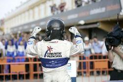 Vitaly Petrov celebrates his victory