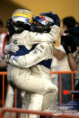 Vitaly Petrov celebrates his victory with Giorgio Pantano
