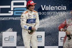 Vitaly Petrov celebrates victory on the podium