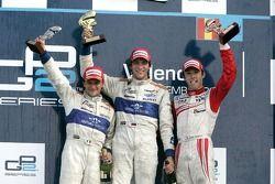Vitaly Petrov celebrates his victory on the podium with Giorgio Pantano and Kazuki Nakajima