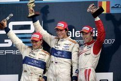 Vitaly Petrov celebrates victory on the podium with Giorgio Pantano and Kazuki Nakajima