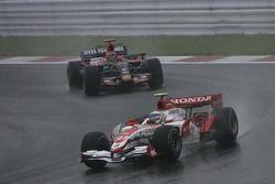 Anthony Davidson, Super Aguri F1 Team, SA07 and Vitantonio Liuzzi, Scuderia Toro Rosso, STR02