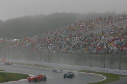 Kimi Raikkonen, Scuderia Ferrari, F2007 and Rubens Barrichello, Honda Racing F1 Team, RA107