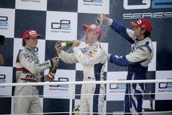 Timo Glock celebrates winning the 2007 GP2 Series Championship on the podium with Javier Villa and A