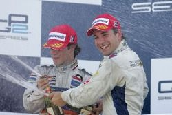 Timo Glock celebrates winning the 2007 GP2 Series title on the podium with Javier Villa