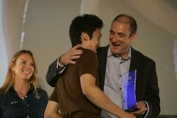 Kazuki Nakajima collects his award from Bruno Michel,