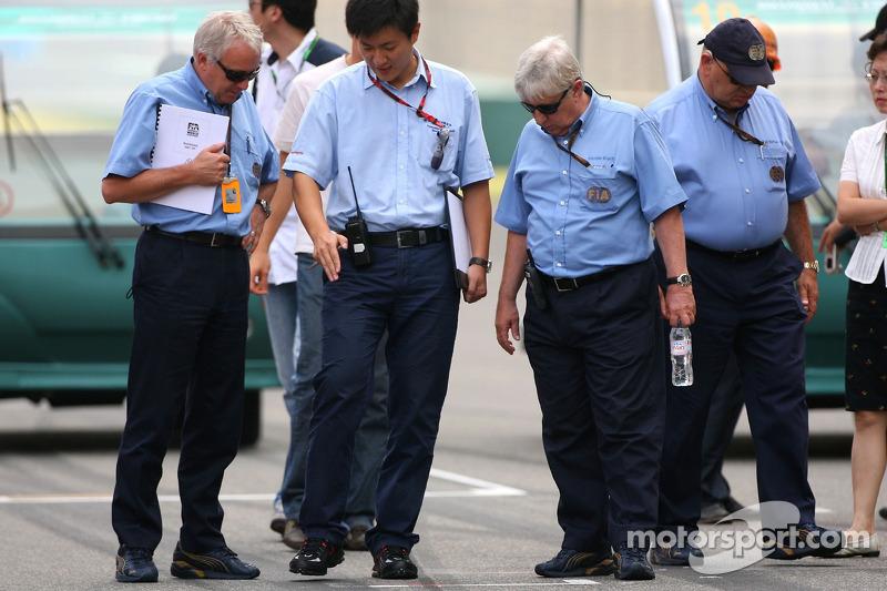 Charlie Whiting, FIA Safty delegate, Race director & offical starter and Herbie Blash, FIA Observer