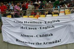 Lewis Hamilton, McLaren Mercedes fans with flag