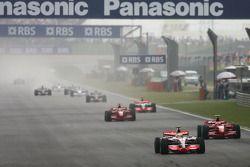 Start, Lewis Hamilton, McLaren Mercedes, MP4-22 leads Kimi Raikkonen, Scuderia Ferrari, F2007 and Fe