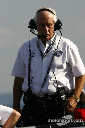 Roger Penske at work in the spotters area atop the grandstands