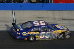 Michael Waltrip on pit road with a damaged car