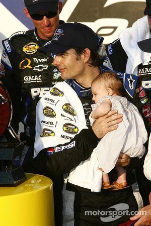 Victory lane: race winner Jeff Gordon celebrates with his baby girl Ella