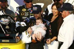 Victory lane: race winner Jeff Gordon celebrates with his baby girl Ella, wife Ingrid and Rick Hendrick