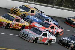 David Stremme on the low side of three wide racing