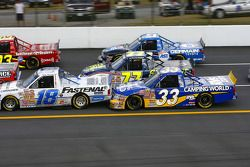 Ron Hornaday is all over the back bumper of Dennis Setzer