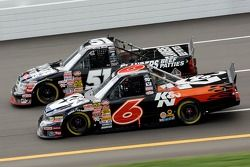 Travis Kvapil and Kyle Busch battle thru the tri-oval