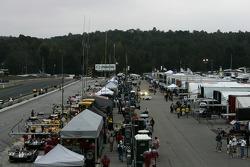 Overall view of the paddock and pitlane activity