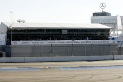 Banners on the Audi Hospitality unit in the paddock