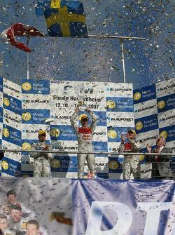Championship podium: 2007 DTM champion Mattias Ekström with second place Bruno Spengler and third p