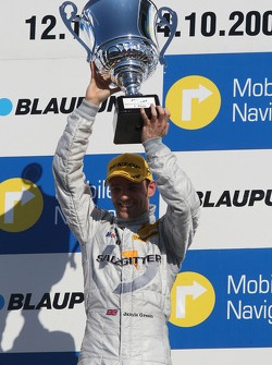 Podium: race winner Jamie Green celebrates