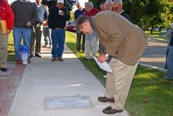 Sam Posey Watkins Glen Walk of Fame induction: Sam Posey inspects the granite stone that will perpetually honor him