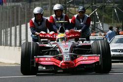 Lewis Hamilton, McLaren Mercedes, MP4-22 is pushed back to Parc Ferme