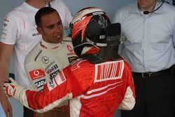 Race winner and 2007 World Champion Kimi Raikkonen congratulated by Lewis Hamilton