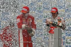 Podium: champagne for Kimi Raikkonen and Fernando Alonso