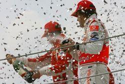 Podium: champagne for Kimi Raikkonen and Fernando Alonso