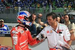 Casey Stoner congratulated by his team member