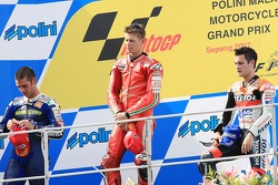 Podio: ganador Casey Stoner, segundo Marco Melandri, tercero Dani Pedrosa