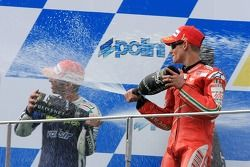 Podium: champagne for Casey Stoner and Marco Melandri